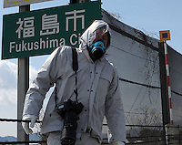 Richard Jones in front of a Fukushima City sign , 60 km from the Fukushima Daiichi Nuclear Power Plant, Japan. Plant was damaged during the  Earthquake and following Tsunami that struck Japan 11th March 2011..17 Mar 2011.