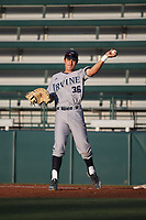 Adrian Damla (36) of the UC Irvine Anteaters throws to his infielders between innings of a game against the Southern California Trojans at Dedeaux Field on April 18, 2017 in Los Angeles, California. UC Irvine defeated Southern California, 14-3. (Larry Goren/Four Seam Images)