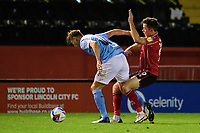 Manchester City U21's Callum Doyle under pressure from Lincoln City's Tom Hopper<br /> <br /> Photographer Chris Vaughan/CameraSport<br /> <br /> EFL Papa John's Trophy - Northern Section - Group E - Lincoln City v Manchester City U21 - Tuesday 17th November 2020 - LNER Stadium - Lincoln<br />  <br /> World Copyright © 2020 CameraSport. All rights reserved. 43 Linden Ave. Countesthorpe. Leicester. England. LE8 5PG - Tel: +44 (0) 116 277 4147 - admin@camerasport.com - www.camerasport.com