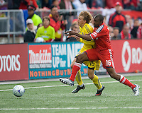 02 May 2009: Columbus Crew midfielder Brian Carroll #16 and Toronto FC defender Marvell Wynne #16 in MLS action at BMO Field in a game between the Columbus Crew and Toronto FC. .The game ended in a 1-1 draw...