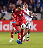 HOUSTON, TX - JANUARY 31: Marta Cox #1 of Panama fights for the ball with Rose Lavelle #16 of the United States during a game between Panama and USWNT at BBVA Stadium on January 31, 2020 in Houston, Texas.
