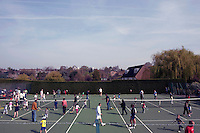 Parents and their children warm up for a coaching session with Dan Bloxham (centre) as part of the Junior Tennis initiative at Wimbledon, The All England Lawn Tennis Club (AELTC), London..