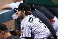 Luis Gonzalez (2) of the Charlotte Knights blows a bubble with his gum while watching from the dugout during the game against the Nashville Sounds at Truist Field on June 4, 2021 in Charlotte, North Carolina. (Brian Westerholt/Four Seam Images)