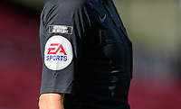 A close up of the EA Sports advertising logo and the not today, or any day anti racism campaign logo on the sleeve of an assistant referees shirt<br /> <br /> Photographer Chris Vaughan/CameraSport<br /> <br /> The EFL Sky Bet League One - Saturday 12th September 2020 - Lincoln City v Oxford United - LNER Stadium - Lincoln<br /> <br /> World Copyright © 2020 CameraSport. All rights reserved. 43 Linden Ave. Countesthorpe. Leicester. England. LE8 5PG - Tel: +44 (0) 116 277 4147 - admin@camerasport.com - www.camerasport.com - Lincoln City v Oxford United