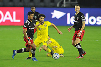 WASHINGTON, DC - OCTOBER 28: Gelmin Rivas #20 of D.C. United battles for the ball with Youness Mokhtar #34 of Columbus Crew SC during a game between Columbus Crew and D.C. United at Audi Field on October 28, 2020 in Washington, DC.