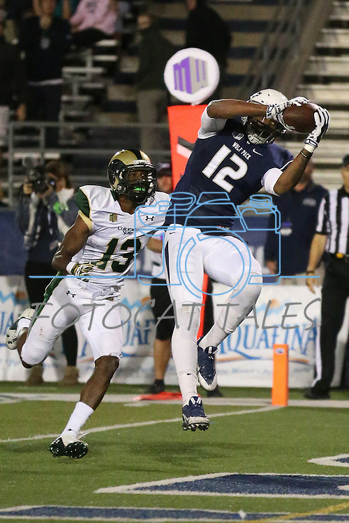 Nevada's Hasaan Henderson (12) catches a touchdown pass against Colorado State's DeAndre Elliott (13) during the second half of an NCAA college football game in Reno, Nev., on Saturday, Oct. 11, 2014. (AP Photo/Cathleen Allison)
