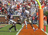 Oct 2, 2010; Charlottesville, VA, USA; Virginia Cavaliers cornerback Devin Wallace (28) watches as Florida State Seminoles wide receiver Willie Haulstead (82) catches a touchdown during the first half of the game at Scott Stadium.  Photo/The Daily Progress/Andrew Shurtleff
