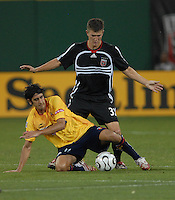 Monarcas Morelia midfielder Gonzalo Choy (11) goes down defending the ball while covered by DC United defender Bobby Boswell (32). Monarcas Morelia tied DC United 1-1 in  the SuperLiga opening match in group B, at RFK Stadium Washington DC, Wednesday July 25, 2007.
