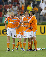 Houston Dynamo players Craig Waibel (16), Richard Mulrooney (30), Brian Ching (25) and Eddie Robinson (2) celebrate a penalty kick. FC Pachuca defeated Houston Dynamo 4-3 in penalty kicks after a 2-2 tie in regulation and extra time at Robertson Stadium in Houston, TX on August 14, 2007 in the Superliga semi-finals.