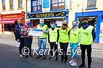 Colman Quirke presents a cheque for €2,000 to Anne O'Sullivan & Annette Fitzpatrick money raided from the Daffodil Day Collection pictured with staff l-r; Naoise Quirke, Sadbh O'Shea, Catherine O'Connell & Niall O'Shea.