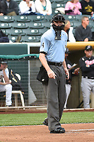 Home plate umpire Scott Mahoney during the game as the Sacramento River Cats played the Salt Lake Bees at Smith's Ballpark on April 3, 2014 in Salt Lake City, Utah.  (Stephen Smith/Four Seam Images)