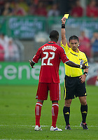 24 July 2010: Toronto FC midfielder Amadou Sanyang #22 recieves a yellow card from the referee during a game between FC Dallas and Toronto FC at BMO Field in Toronto..The final score was a 1-1 draw...
