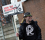 © Joel Goodman - 07973 332324 .  12/01/2015 . Salford , UK . A Reality Party campaigner . Bez ( Mark Berry ) launches his parliamentary campaign for the constituency of Salford and Eccles at a poster site on Chapel Street , Salford . Bez , the freaky dancer from Madchester band The Happy Mondays , is standing for The Reality Party . Seat incumbent , Labour's Hazel Blears , is standing down at the 2015 election . Photo credit : Joel Goodman