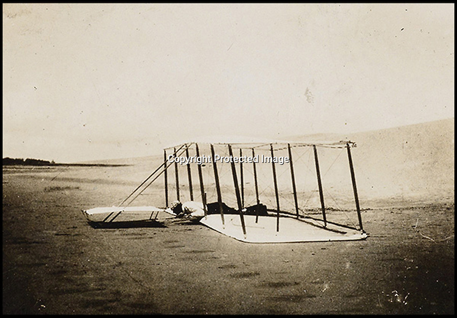 BNPS.co.uk (01202 558833)<br /> Pic: SwannAuctions/BNPS<br /> <br /> ***Please use full byline***<br /> <br /> Wilbur Wright making a landing after a glide in 1901.<br /> <br /> A fascinating archive of previously unseen photographs documenting the Wright Brothers' pioneering advances in early flight has come to light.<br /> <br /> The black and white photos chart Wilbur and Orville Wright's work developing their rudimentary aircraft in the years following their historic first powered flight in 1903.<br /> <br /> The collection was compiled by aviation enthusiast Walt Burton, who bought two albums of photos of the Wright Brothers from Frank Hermes, a businessman who paid the pair to fly his freight around.<br /> <br /> It expected to fetch upwards of £20,000 when it goes under the hammer at Swann Auction Galleries.