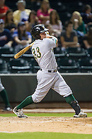Will Skinner (33) of the Lynchburg Hillcats follows through on his swing against the Winston-Salem Dash at BB&T Ballpark on August 13, 2014 in Winston-Salem, North Carolina.  The Hillcats defeated the Dash 4-3.   (Brian Westerholt/Four Seam Images)