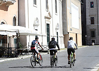 Three men ride bicycles in Piazza Navona in central Rome on May 4, 2020 as Italy starts to ease its lockdown, during the countrys lockdown aimed at curbing the spread of the COVID-19 infection, caused by the novel coronavirus.<br /> UPDATE IMAGES PRESS/Isabella Bonotto