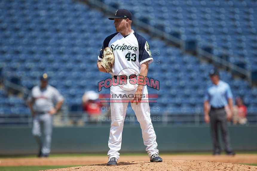 Gwinnett Stripers relief pitcher Corbin Clouse (43) looks to his catcher for the sign against the Scranton/Wilkes-Barre RailRiders at Coolray Field on August 18, 2019 in Lawrenceville, Georgia. The RailRiders defeated the Stripers 9-3. (Brian Westerholt/Four Seam Images)