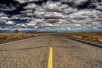 Indian Route 13 under a stormy sky as it approaches Shiprock in northwestern New Mexico.