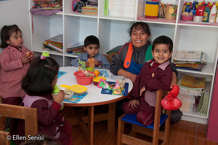 Arequipa, Peru. Hefziba, a parochial (Christian), private school for elementary and secondary school students. Portrait of students (pre-school aged, Peruvian) and teacher (Peruvian) at lunchtime. No MR. ID: AL-peru.