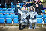 Oxford United 1 Accrington Stanley 2, 20/02/2016. Kassam Stadium, League Two. Oxford's home ground is the Kassam Stadium in Oxford and has a capacity of 12,500. United moved to the stadium in 2001 after leaving the Manor Ground, their home for 76 years. Oxford supporters shelter from the rain. Photo by Simon Gill.