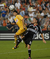 Club America defender Ricardo Rojas (16) goes up for the header against DC United defender Bobby Boswell (32). DC United defeated Club America 1-0 to secure one of the two semifinal berths in SuperLiga group B, at RFK Stadium in Washington DC, Sunday July 29, 2007.