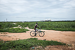 CAR, Bangui: Zone of the Mpoko camp next to the runway of the Mpoko airport. In order to reach the other part of the camp on the other side of the runway, people have to wait that the plane passes before crossing.  17th April 2016.<br /> RCA, Bangui : Zone du camp Mpoko à côté de la piste de l'aéroport Mpoko . Afin d' atteindre l'autre partie du camp de l'autre côté de la piste , les gens doivent attendre que l'avion passe avant de traverser . 17 avril 2016.
