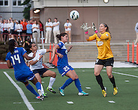Boston Breakers goalkeeper Ashley Phillips (24) runs forward to catch the ball with Boston Breakers midfielder Jo Dragotta (25) and Boston Breakers defender Kia McNeill (14) defending from Sky Blue FC forward Monica Ocampo (8).  In a National Women's Soccer League Elite (NWSL) match, Sky Blue FC defeated the Boston Breakers, 3-2, at Dilboy Stadium on June 16, 2013