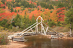 Fall view of a footbridge on the trail around Jordan Pond, Acadia National Park, Maine, USA