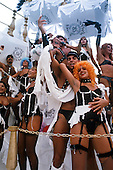Rio de Janeiro, Brazil. Samba dancers in bondage and lingerie themed costumes during the carnival parade.