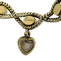 BNPS.co.uk (01202 558833)<br /> Pic: Fellows/BNPS<br /> <br /> Pictured: The only lock which remains in the gold and turquoise heart-shaped bracelet 170 years later is from Princess Helena - the queen's fifth child. <br /> <br /> A poignant bracelet that belonged to Queen Victoria and still contains a lock of her daughter's hair has sold for almost £4000.<br /> <br /> The extraordinary piece of jewellery has five lockets attached to it and each would have held strands of hair of her children at the time.<br /> <br /> She had the names of Princesses Victoria, Alice, Louise and Helena and Prince Alfred engraved on the bracelet.