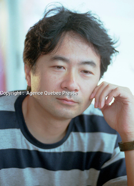 July 31 1999, Montreal,(Quebec), CANADA.<br /> <br /> Japanese filmmaker Shusuke Kaneko during at interview about his latest movie ``  Gamera 3 `` presented at the 4th FantAsia Film Festival in Montreal (Canada). He also directed the 2 previous Gamera movies as well as many erotic movies.<br /> <br /> . (©) Copyright 1999 by Pierre Roussel <br /> <br /> <br /> NOTE : Scan from 35mm negative.