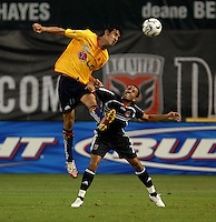 Monarcas Morelia Gonzalo Choy (11) goes up for the header against DC United midfielder Fred (7). Monarcas Morelia tied DC United 1-1 i  the SuperLiga opening match in group B, at RFK Stadium Washington DC, Wednesday July 25, 2007.
