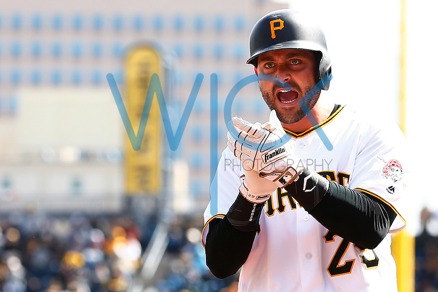 Francisco Cervelli #29 of the Pittsburgh Pirates reacts after scoring in the sixth inning against the St. Louis Cardinals during the Opening Day game at PNC Park in Pittsburgh, Pennsylvania on April 3, 2016. (Photo by Jared Wickerham / DKPS)