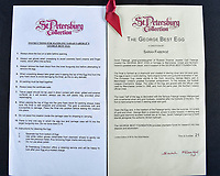 BNPS.co.uk (01202 558833)<br /> Pic: Dukes/BNPS<br /> <br /> Cetificates of Authenticity.<br /> <br /> On Me Egg, Son...<br /> <br /> A rare Faberge egg made to commemorate George Best's leading role in Manchester United's first ever European Cup win has emerged for sale for £18,000.<br /> <br /> The 24-carat gold egg has a detachable top which can be removed to reveal a small statue of the legendary footballer.<br /> <br /> He has a diamond studded football at his feet and looks poised to set off on a trademark dribble.