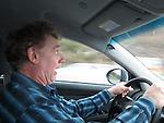 John driving in Italy.