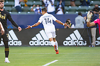 CARSON, CA - MAY 8: Javier Hernandez #14 of the Los Angeles Galaxy scores and celebrates during a game between Los Angeles FC and Los Angeles Galaxy at Dignity Health Sports Park on May 8, 2021 in Carson, California.