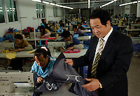 Managing director of General Union Stationary & Gift Co. Ltd, Chen Te-Lung, poses in his bag factory on the outskirts of Fuzhou City, China. The Taiwanese businessman has ammasses a fortune in Mainland China..02-MAR-04