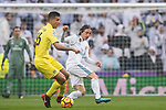 Luka Modric (R) of Real Madrid fights for the ball with Rodrigo Hernandez Cascante, Rodri, of Villarreal CF during the La Liga 2017-18 match between Real Madrid and Villarreal CF at Santiago Bernabeu Stadium on January 13 2018 in Madrid, Spain. Photo by Diego Gonzalez / Power Sport Images