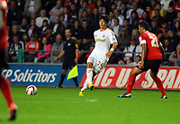 Pictured: Ki Sung-Yueng of Swansea (L). Tuesday 28 August 2012<br /> Re: Capital One Cup game, Swansea City FC v Barnsley at the Liberty Stadium, south Wales.