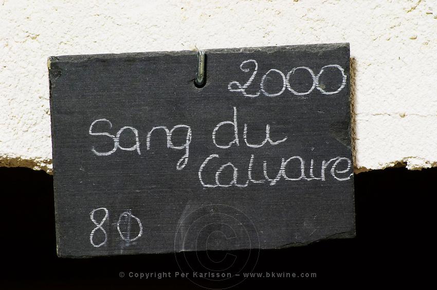 Bin label 2000 Sang du Calvaire. Domaine Cazeneuve in Lauret. Pic St Loup. Languedoc. Bottle cellar. France. Europe. Bins with bottles.