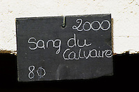 Bin label 2000 Sang du Calvaire. Domaine Cazeneuve in Lauret. Pic St Loup. Languedoc. Bottle cellar. France. Europe. Bins with bottles.