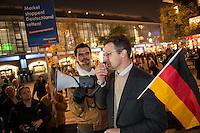 """AfD protestiert in Berlin gegen die Fluechtlingspolitik der Bundesregierung.<br /> Am Samstag den 31. Oktober 2015 versammelten sich ca. 250 Anhaenger der Rechts-Partei Alternative fuer Deutschland (AfD) zu einer Kundgebung gegen die Fluechtlings- und Asylpolitik der Bundesregierung. Dabei wurde die Bundeskanzlerin Angela Merkel mehrfach scharf angegriffen. Die Berichterstattung ueber Fluechtlinge in den Medien wurde mit lautstarken Rufen """"Luegenpresse"""" beschimpft.<br /> Der brandenburgische Landesvorsitzende Gauland forderte eine Fluechtlingspolitik wie in Japan, wo angeblich nur 20 Fluechtlinge pro Jahr aufgenommen werden.<br /> Etwa 350 Menschen protestierten gegen die Veranstaltung der Rechten und blockierten kurzzeitig deren Marschroute. Die Polizei ordnete daraufhin eine verkuerzte Route an und raeumte dafuer der AfD den Weg frei.<br /> Rechts im Bild: Marcus Pretzell, AfD-Landesvorsitzender aus Nordrhein-Westfalen redet zu den AfD-Anhaengern.<br /> 31.10.2015, Berlin<br /> Copyright: Christian-Ditsch.de<br /> [Inhaltsveraendernde Manipulation des Fotos nur nach ausdruecklicher Genehmigung des Fotografen. Vereinbarungen ueber Abtretung von Persoenlichkeitsrechten/Model Release der abgebildeten Person/Personen liegen nicht vor. NO MODEL RELEASE! Nur fuer Redaktionelle Zwecke. Don't publish without copyright Christian-Ditsch.de, Veroeffentlichung nur mit Fotografennennung, sowie gegen Honorar, MwSt. und Beleg. Konto: I N G - D i B a, IBAN DE58500105175400192269, BIC INGDDEFFXXX, Kontakt: post@christian-ditsch.de<br /> Bei der Bearbeitung der Dateiinformationen darf die Urheberkennzeichnung in den EXIF- und  IPTC-Daten nicht entfernt werden, diese sind in digitalen Medien nach §95c UrhG rechtlich geschuetzt. Der Urhebervermerk wird gemaess §13 UrhG verlangt.]"""