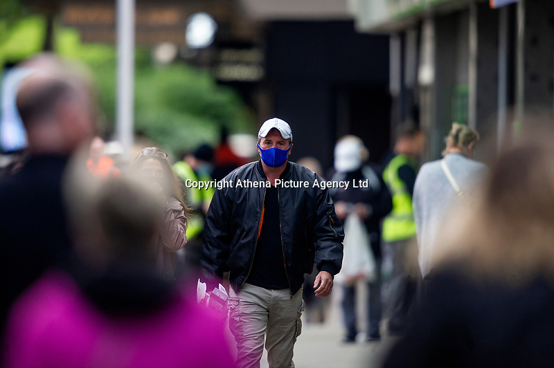 Pictured: A man walks down Oxford Street, Swansea city centre, Wales, UK. Monday 28 September 2020<br /> Re: Local lockdown will be in force from 6pm on the 27th September 2020 due to the Covid-19 Coronavirus pandemic, in Swansea, Wales, UK.