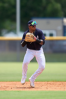 FCL Yankees shortstop Roberto Chirinos (57) throws to first base during a game against the FCL Blue Jays on June 29, 2021 at the Yankees Minor League Complex in Tampa, Florida.  (Mike Janes/Four Seam Images)