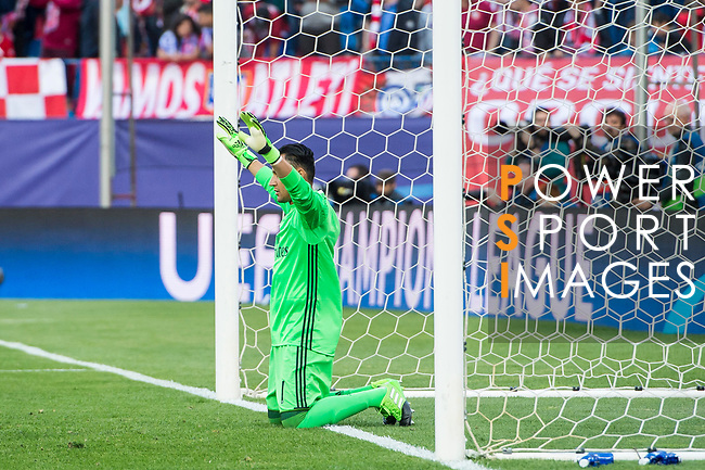 Goalkeeper Keylor Navas of Real Madrid prays during their 2016-17 UEFA Champions League Semifinals 2nd leg match between Atletico de Madrid and Real Madrid at the Estadio Vicente Calderon on 10 May 2017 in Madrid, Spain. Photo by Diego Gonzalez Souto / Power Sport Images