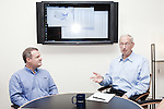 July 29, 2011. Cary, NC.. John Sall, the Executive VP of SAS, right, meets with Jon Weisz, Director of Sales and Marketing, in his office.. Profile of SAS, a software company that has many amenities for its employees.