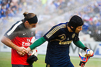 Paris Saint-Germain goalkeeper Ronan Le Crom (40) and Chelsea FC goalkeeper Petr Cech (1) get hit with the sprinklers before the match. Chelsea FC and Paris Saint-Germain played to a 1-1 tie during a 2012 Herbalife World Football Challenge match at Yankee Stadium in New York, NY, on July 22, 2012.
