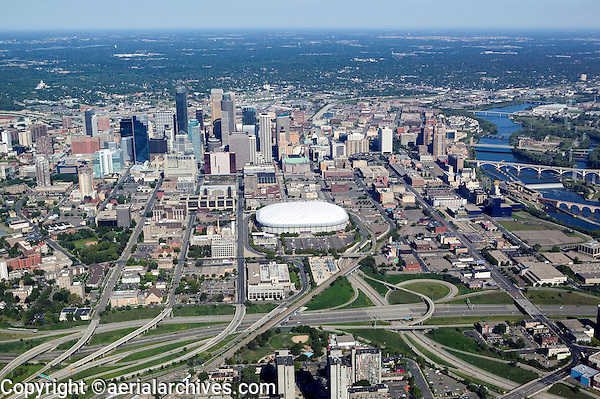 aerial above Minneapolis, MN from the south toward the Metrodome and downtown with the Mississippi river on the right