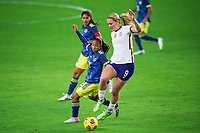 ORLANDO, FL - JANUARY 18: Lindsey Horan #9 of the USWNT battles for the ball during a game between Colombia and USWNT at Exploria Stadium on January 18, 2021 in Orlando, Florida.