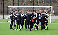 Thursday 11 April 2013<br /> Pictured: Swansea coaching staff confer before kick off.<br /> Re: Friendly game, Swansea City FC coaching staff v sports reporters at the Swansea City FC training ground. Final score 10-4.